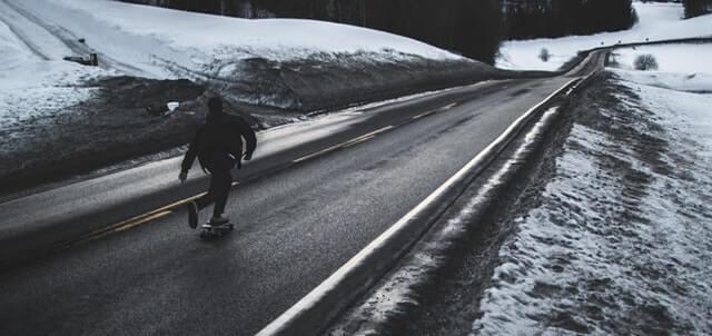 Guy riding skateboard on roads